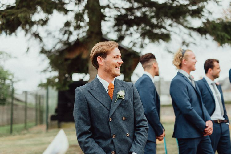 Groom in Blue Thomas Farthing Suit with Ochre Tie | Rustic French Destination Wedding with Homegrown Flowers  | Emily & Steve Photography