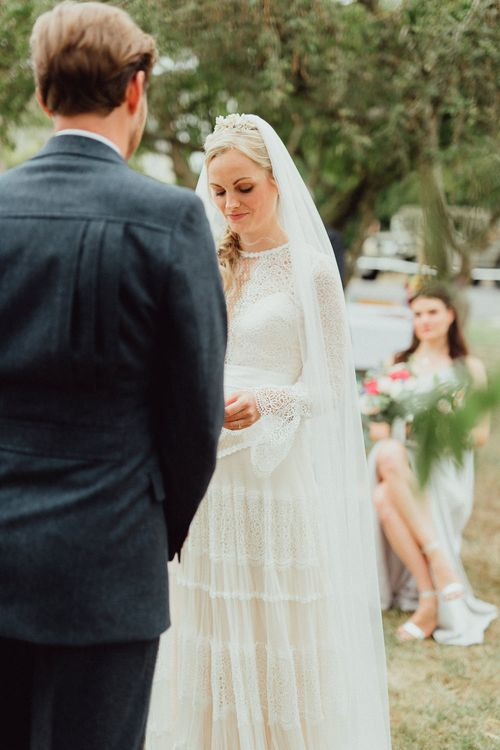 Wedding Ceremony | Bride in Laced Catherine Deane Wedding Dress with Long Sleeves | Rustic French Destination Wedding with Homegrown Flowers  | Emily & Steve Photography