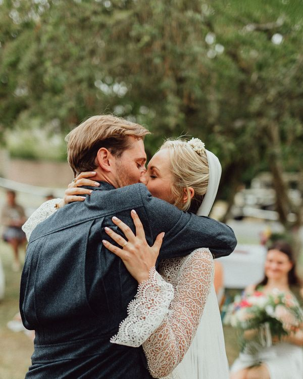 Wedding Ceremony | Bride in Laced Catherine Deane Wedding Dress with Long Sleeves | Groom in Blue Thomas Farthing Suit with Ochre Tie | Rustic French Destination Wedding with Homegrown Flowers  | Emily & Steve Photography