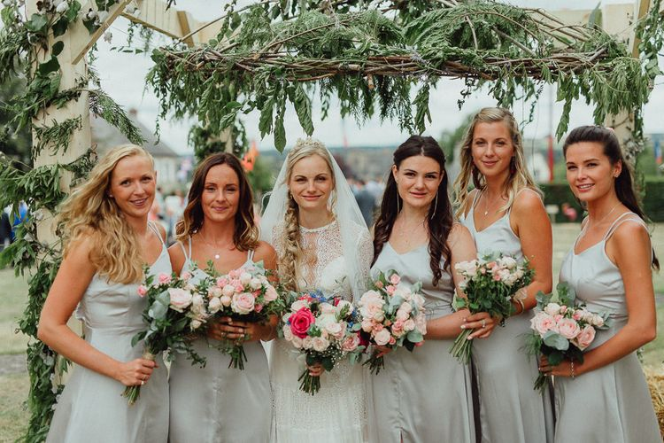 Bride in Laced Catherine Deane Wedding Dress with Long Sleeves | Bridesmaids in Grey Silk Fred Dresses | Foliage Arch | Rustic French Destination Wedding with Homegrown Flowers  | Emily & Steve Photography