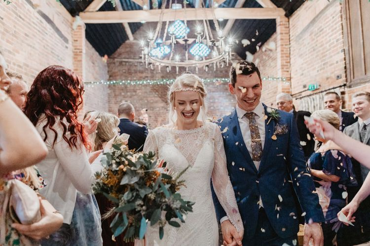 Confetti Moment with Bride in Lace Allure Bridals Wedding Dress and Groom in Navy Hugo Boss Suit