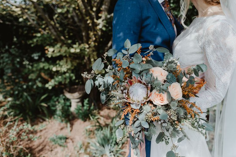 Wedding Bouquet with Eucalyptus, Peach Roses and Proteas