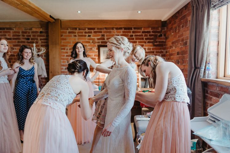 Wedding Morning with Bridesmaids Helping Bride into Her Allure Bridals Wedding Dress