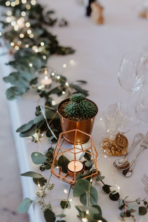 Copper Wedding Decor with Fairy Lights and Eucalyptus