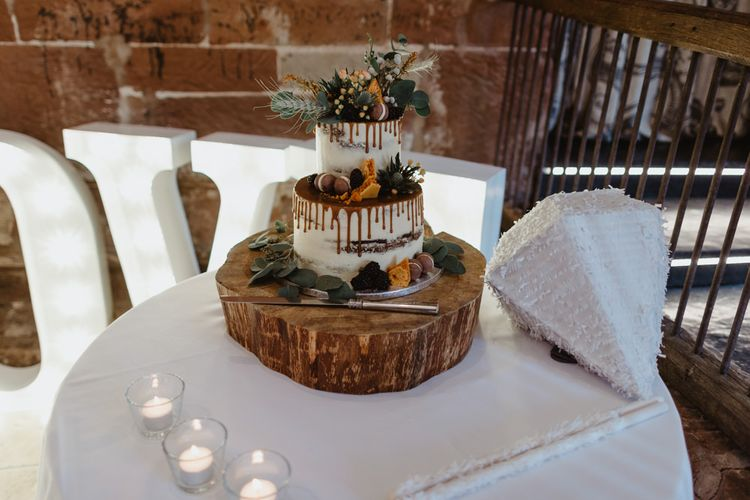 Drip, Semi-Naked Wedding Cake on Tree Stump Cake Stand