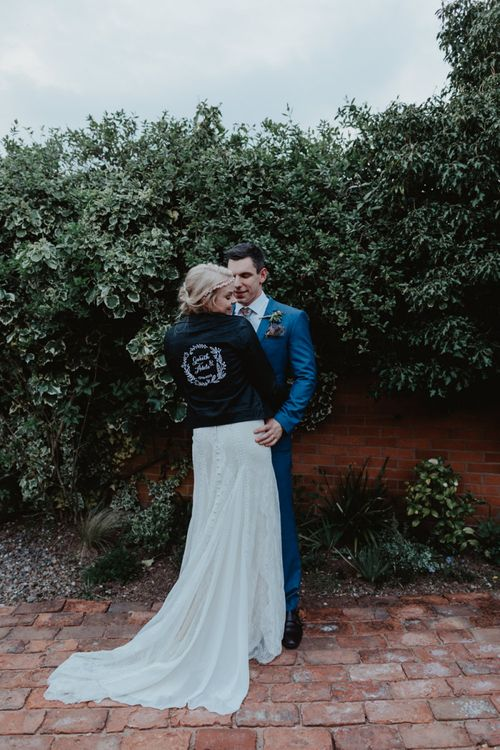 Bride in Lace Allure Bridals Wedding Dress and Customised Leather Jacket