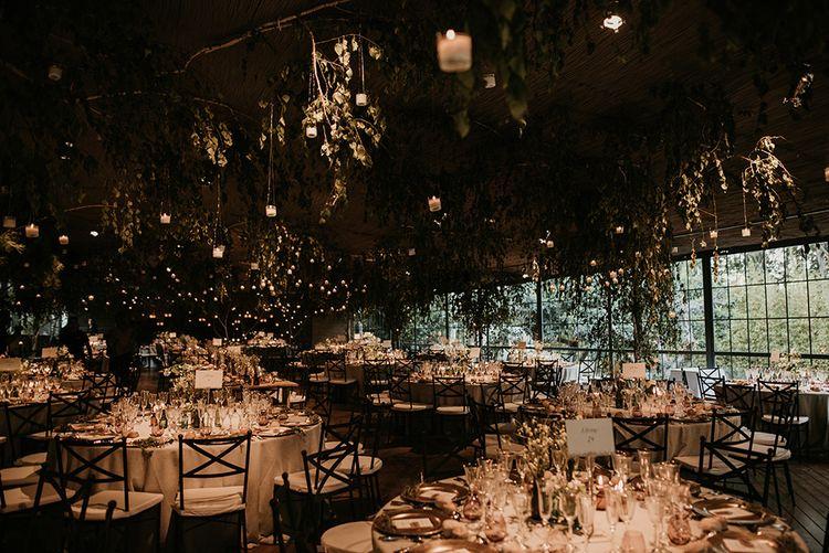 Foliage & Fairy Light Wedding Reception Decor | Authentic Spanish Wedding at Masia Ribas, Barcelona | Sara Lobla Photography
