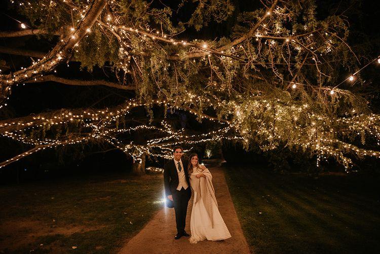 Festoon Lights | Bride in Simple & Elegant Teresa Helbig Wedding Dress  | Groom in Traditional Tails | Authentic Spanish Wedding at Masia Ribas, Barcelona | Sara Lobla Photography