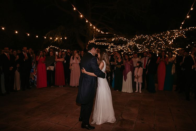 First Dance under Fairy Lights | Bride in Simple & Elegant Teresa Helbig Wedding Dress  | Groom in Traditional Tails | Authentic Spanish Wedding at Masia Ribas, Barcelona | Sara Lobla Photography
