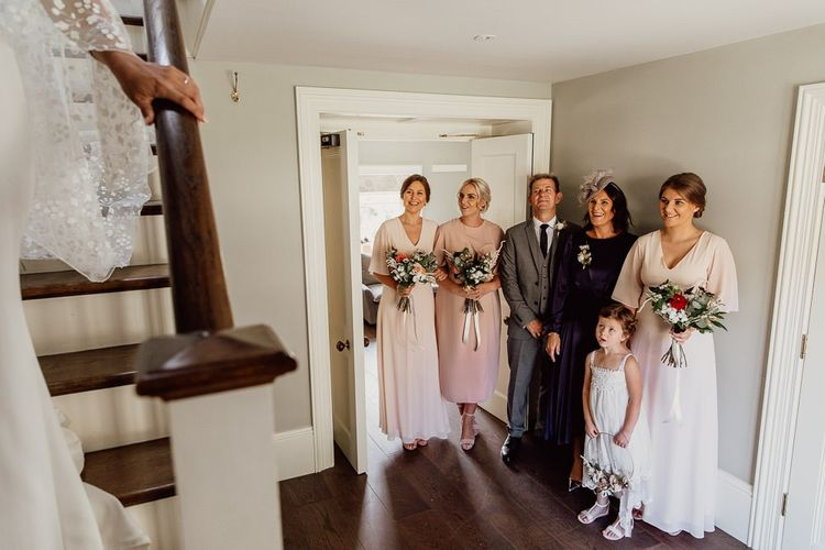 Bridal party see bride for first time at Norfolk barn wedding