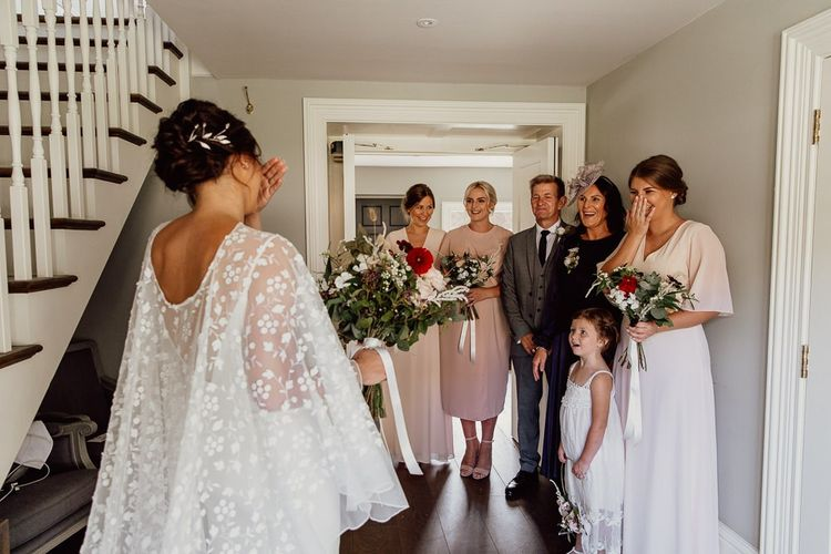 Bridal party see bride in cape  for first time at Norfolk barn wedding