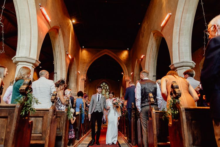 Bride and groom during church ceremony before Norfolk barn wedding reception