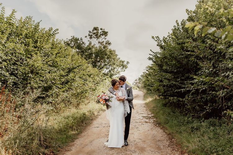 Bride and groom in the ground of the Norfolk barn wedding venue