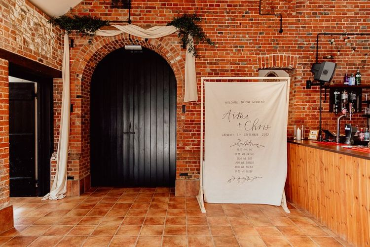 Norfolk barn wedding with linen sign
