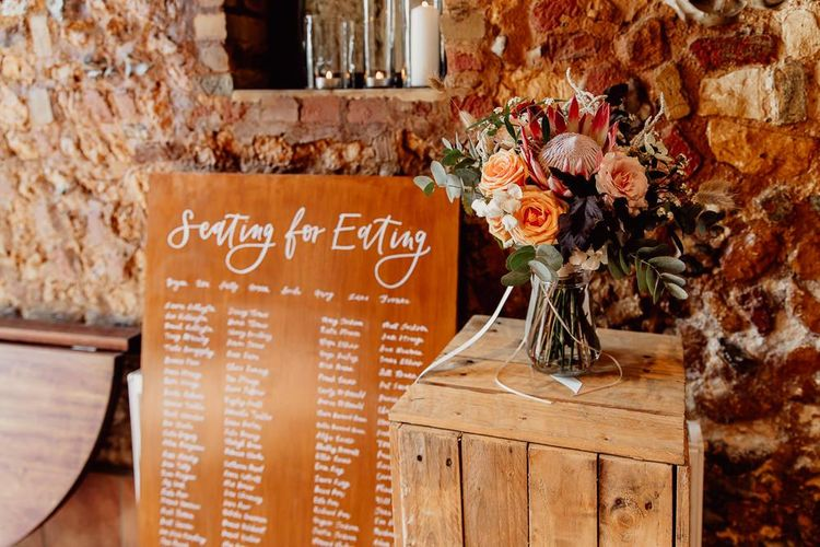 Wooden wedding signs and floral displays