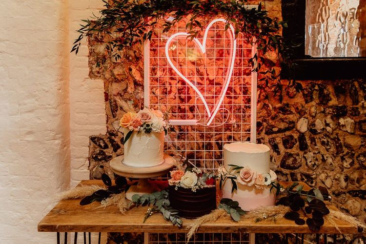 Cake table with neon love heart wedding sign