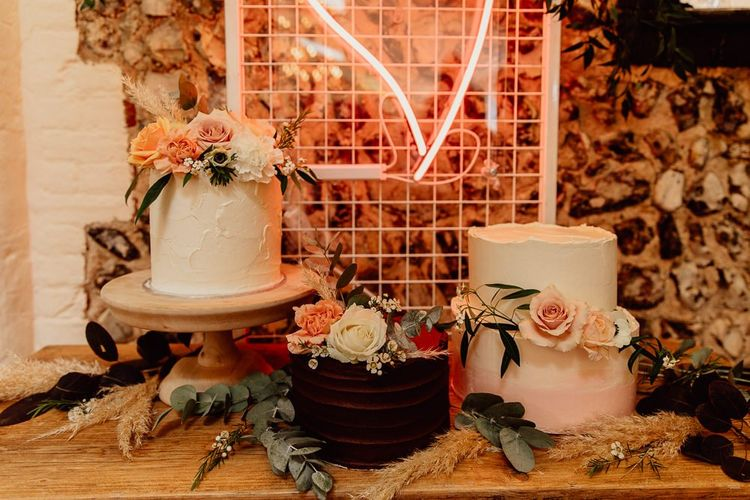 Separated wedding cake tiers with floral decor