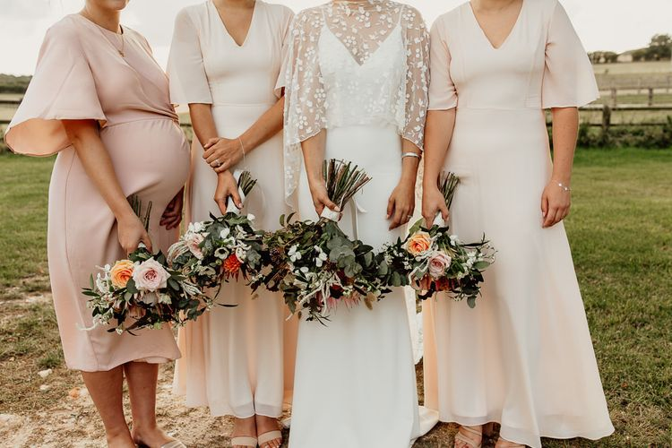 Blush bridesmaid dresses from ASOS with pregnant bridesmaid in ASOS Maternity