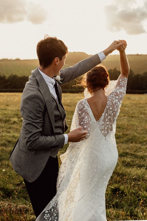 Bride and groom steal a moment during sunset at Norfolk barn wedding venue