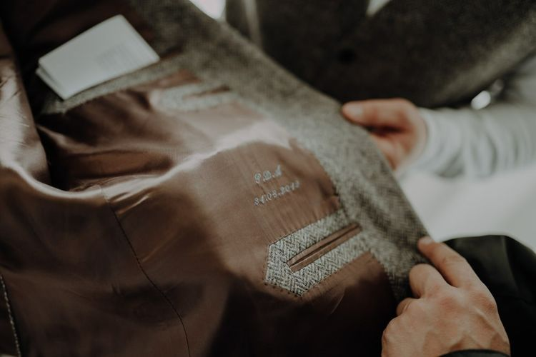 Bespoke grooms suit with wedding date embroidery