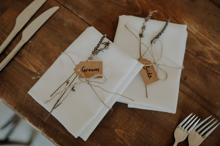 Hand tied place settings with name tags and lavender
