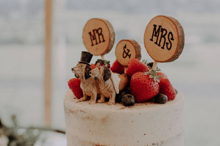 Rustic tree stump Mr & Mrs wedding cake topper with dogs and berry decor