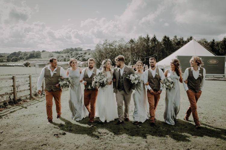 Bride and groom with their wedding party at Hobbit Hill for marquee reception