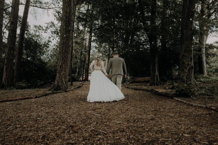 Bride and groom steal a moment at Hobbit Hill for outdoor country wedding with festival touches