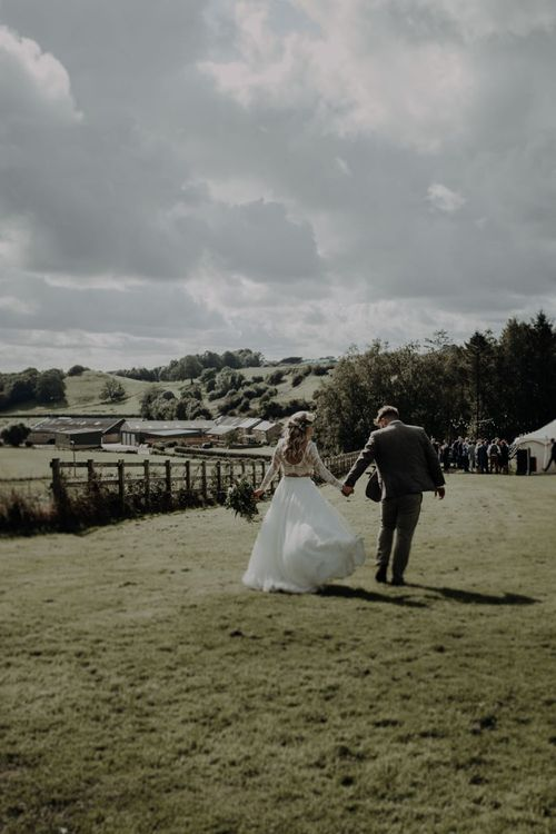 Bride and groom taking in the views of the rolling hills and fields at Hobbit Hill for outdoor wedding