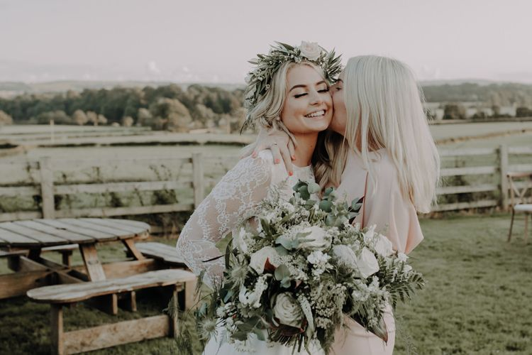 Bride wearing white floral headpiece and two piece bridal dress at Hobbit Hill wedding