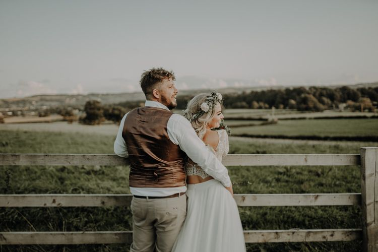 Bride and groom enjoy their outdoor wedding at Hobbit Hill with relaxed festival styling