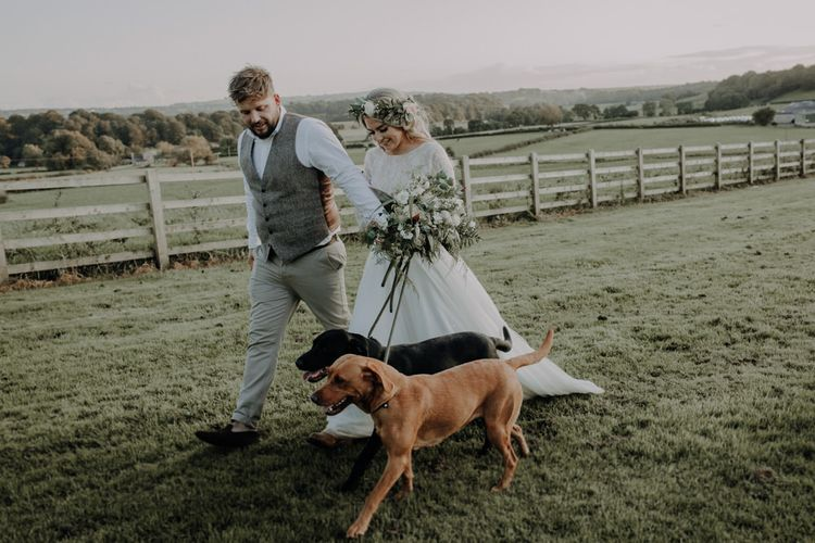 Bride and grooms dogs arrive to steal the show at their outdoor wedding