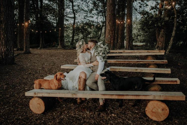 Bride and groom take a moment with their dogs at Hobbit Hill for outdoor wedding with country styling