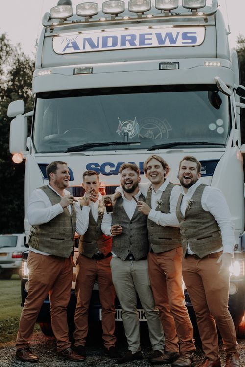 Groom and his groomsmen celebrate at Hobbit Hill for outdoor country wedding