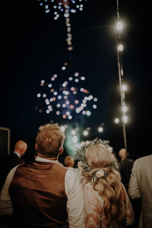 Bride and groom enjoy the fireworks at Hobbit Hill for outdoor country wedding