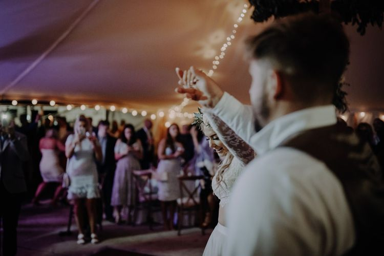 Couples first dance at Hobbit Hill with marquee reception