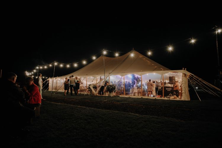 Marquee reception at Hobbit Hill styled with fairy lights