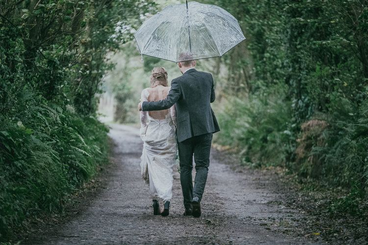 Bride and Groom Embracing in the Countryside
