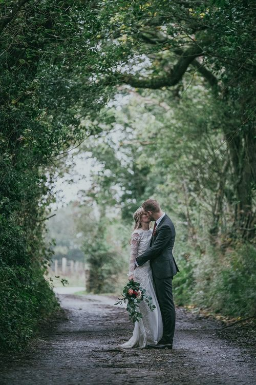 Bride and Groom Kissing in the Countryside