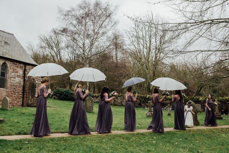 Bridemaids with umbrellas