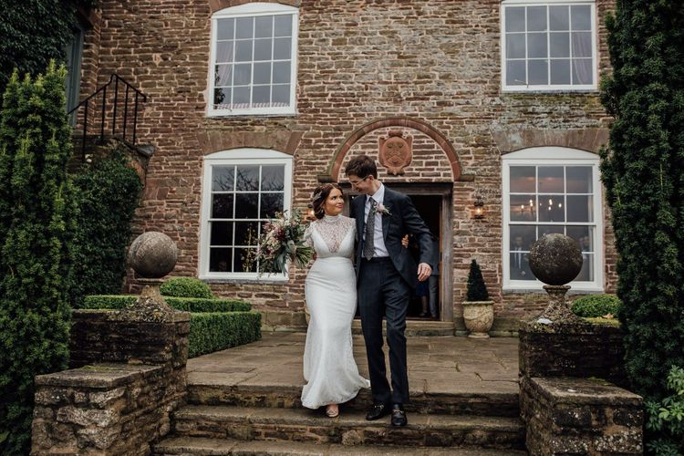 Bride and Groom outside Dewsall Court