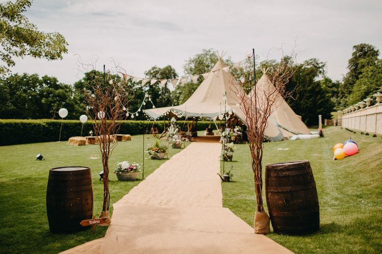 Tipi Entrance with Barrels & Bunting & Festoon Lights  | DIY Rustic Tipi Wedding at Riverhill Gardens, Sevenoaks | Frances Sales Photography