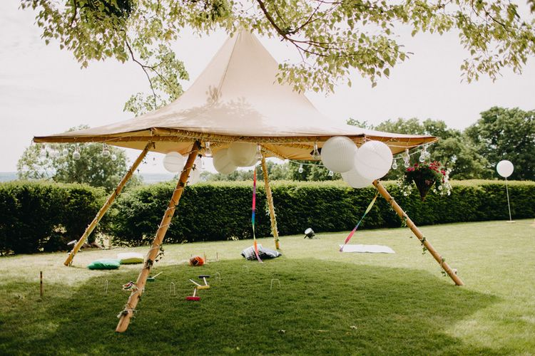 Naked Tipi Shaded Area with Giant Balloons Wedding Decor | DIY Rustic Tipi Wedding at Riverhill Gardens, Sevenoaks | Frances Sales Photography