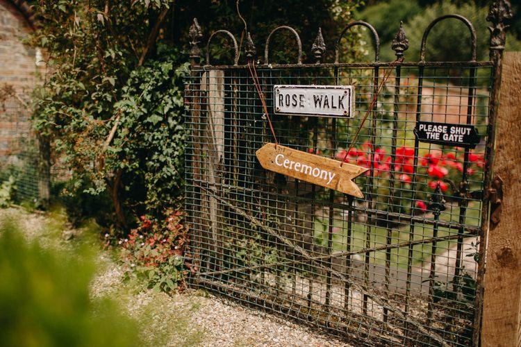 Wooden Arrow Direction Sign | DIY Rustic Tipi Wedding at Riverhill Gardens, Sevenoaks | Frances Sales Photography