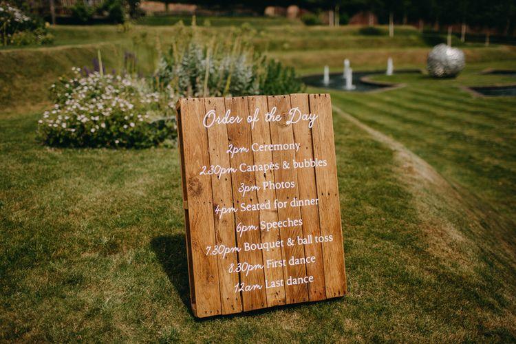 Wooden Order of the Day Wedding Sign | DIY Rustic Tipi Wedding at Riverhill Gardens, Sevenoaks | Frances Sales Photography