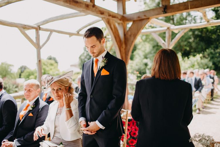 Groom in Moss Bros. Suit at the Altar | DIY Rustic Tipi Wedding at Riverhill Gardens, Sevenoaks | Frances Sales Photography