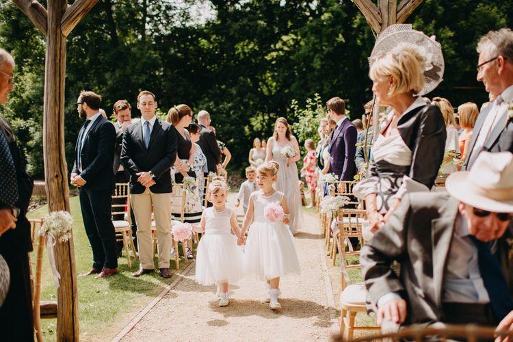 Wedding Ceremony Flower Girl Entrance | DIY Rustic Tipi Wedding at Riverhill Gardens, Sevenoaks | Frances Sales Photography