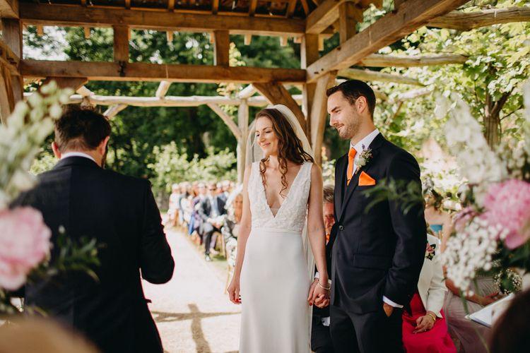 Wedding Ceremony | Bride in Halo & Wren Wedding Dress | Groom in Moss Bros. Suit | DIY Rustic Tipi Wedding at Riverhill Gardens, Sevenoaks | Frances Sales Photography