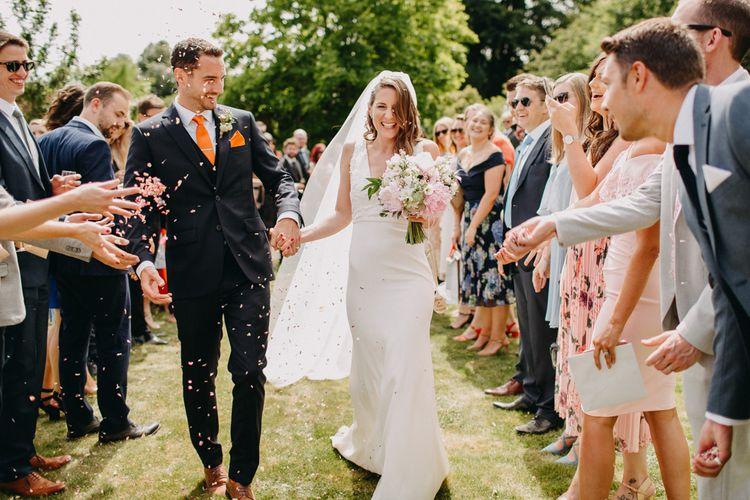 Confetti Moment | Bride in Halo & Wren Wedding Dress | Groom in Moss Bros. Suit | DIY Rustic Tipi Wedding at Riverhill Gardens, Sevenoaks | Frances Sales Photography