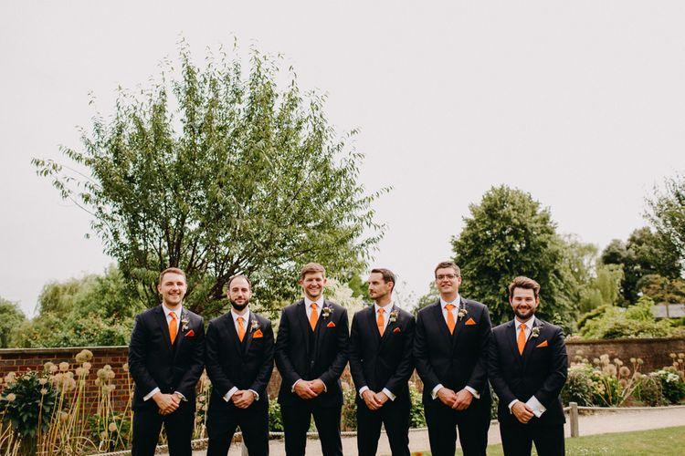 Groomsmen in Moss Bros. Suits & Orange Ties | DIY Rustic Tipi Wedding at Riverhill Gardens, Sevenoaks | Frances Sales Photography